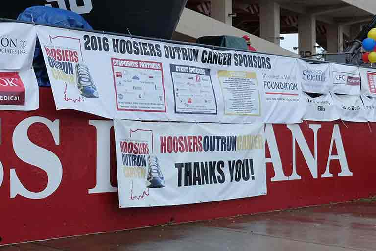 2016 Hoosiers Outrun Cancer banner and stage.
