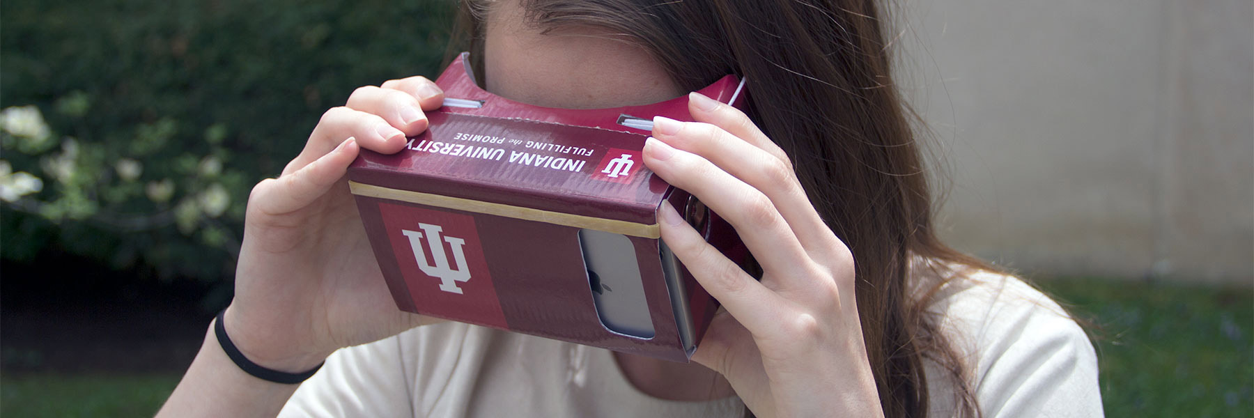 IU student viewing a IU virtual tour using a cardboard viewer.