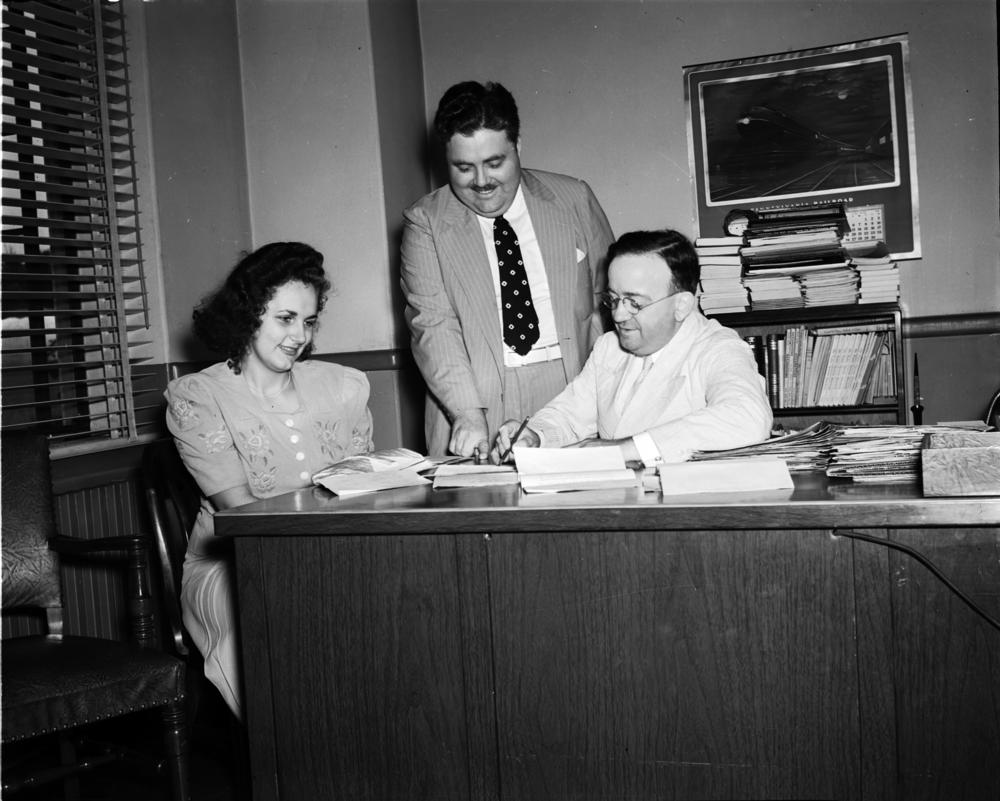 Black and white photo of Louise McNutt, Herman B Wells and Frank Elliott